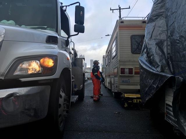 As RV Wastewater Pilot Program coordinator for Seattle Public Utilities, Chris Wilkerson visits people living in motor homes and trailers and offers to pump out their waste for free.