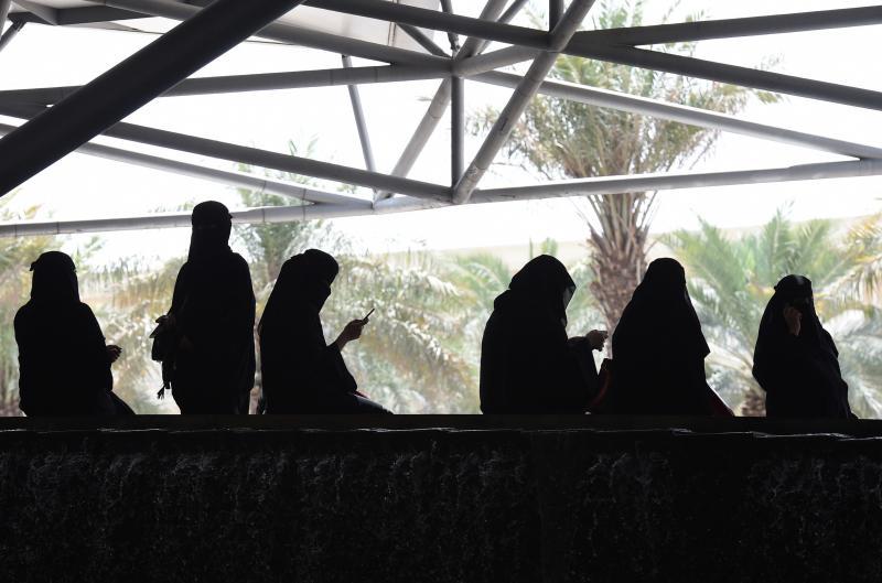Saudi women wait for their drivers outside a hotel in the Saudi capital Riyadh.