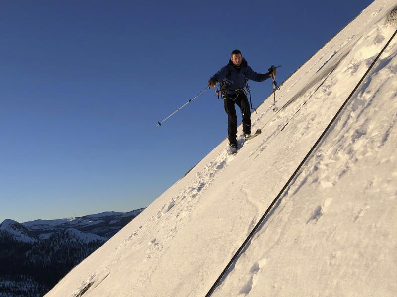 In this photo provided by Jason Torlano, Zach Milligan is shown on his descent down Half Dome in Yosemite National Park, Calif., on Feb. 21. The two men climbed some 4,000 feet to the top of Yosemite's Half Dome in subfreezing temperatures and skied down