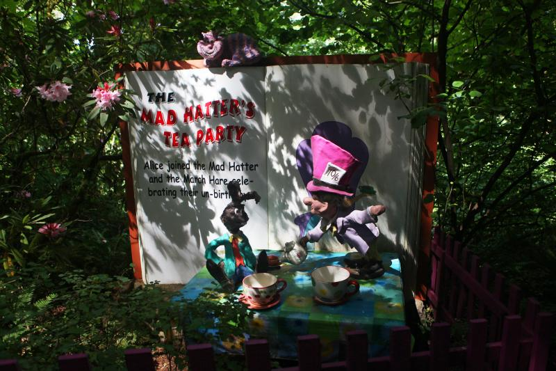 A scene from Storybook Lane features The Mad Hatter from Alice's Adventures in Wonderland.
