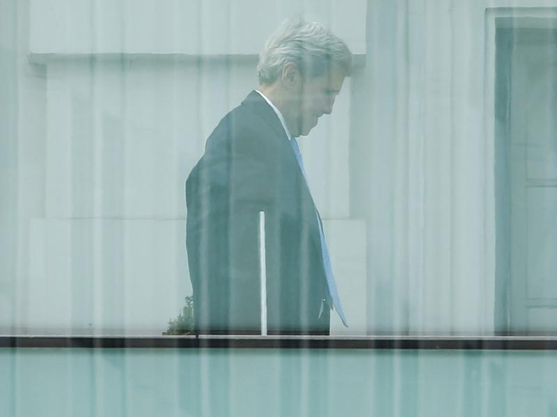 Secretary of State John Kerry walks on the terrace of Palais Coburg, the venue for nuclear talks in Vienna, on Sunday.