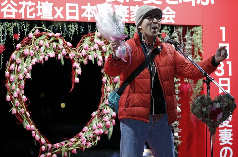 A man shouts his love at an event in Tokyo on Jan. 29. The event comes two days ahead of Beloved Wives Day, a day on which husbands publicly scream their love for their wives before a crowd of onlookers. Husbands are also urged to head home early to expre