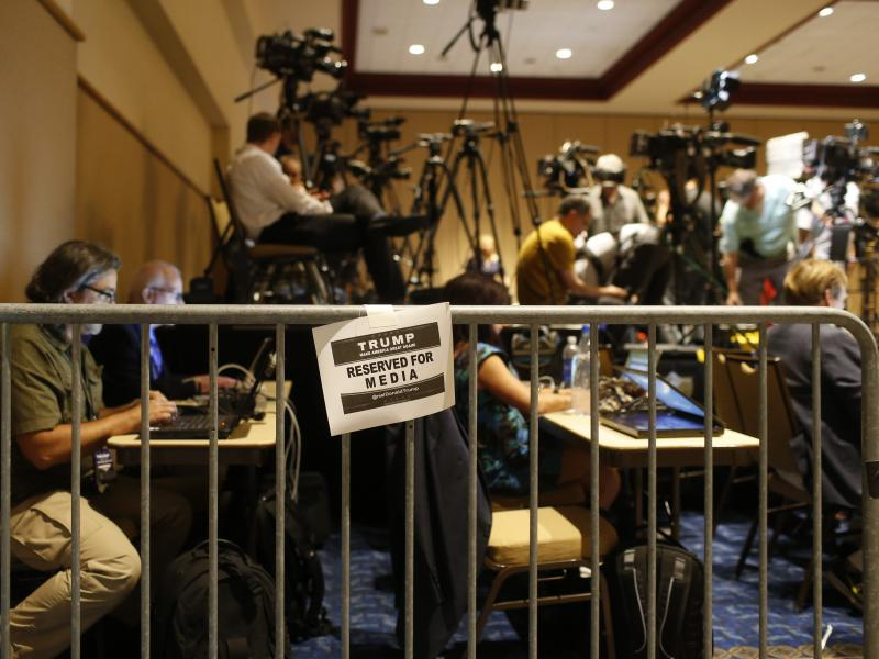 Journalists work in the Trump campaign's designated media pen as they wait for the candidate to arrive at a town hall meeting on March 14 in Tampa, Fla. Foreign journalists covering the campaign say gaining official access to Trump events has been more ch