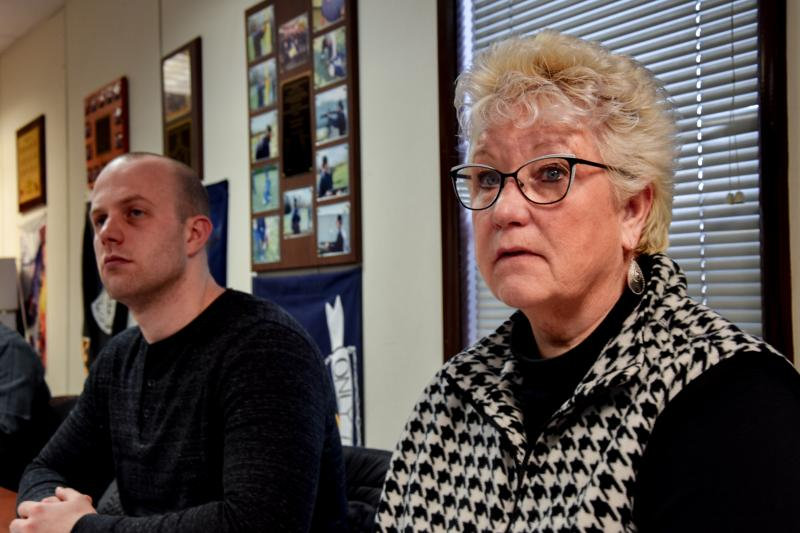 Patti Saylor sits next to David Roberts, an officer with the Calvert County Sheriff's Office, during a training session at Prince George's Community College.