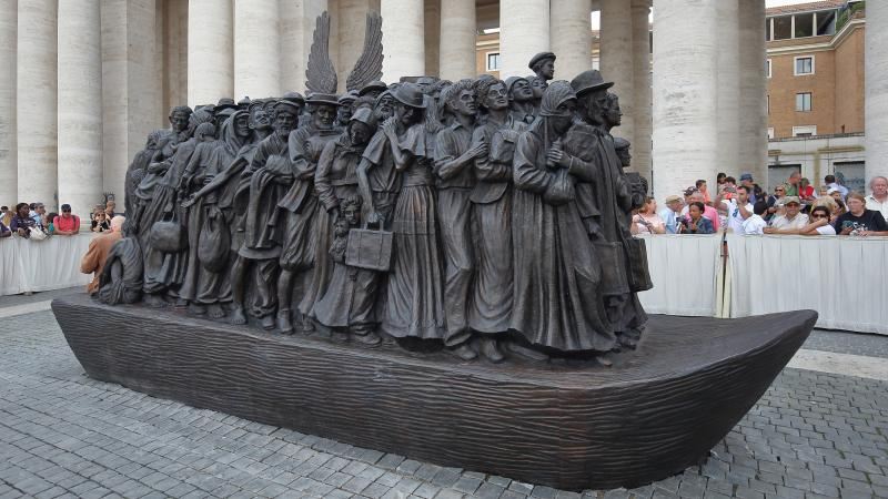 The 20-foot-tall bronze sculpture of a boat loaded with refugees and migrants is the work of Canadian sculptor Timothy Schmalz. Its bread-and-fruit motif encapsulates how food is interlocked with the history of human migration.