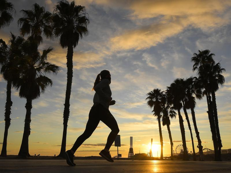 A jogger runs on Santa Monica State Beach on April 10 in Santa Monica, Calif. Running is one form of exercise that meets social distancing guidelines.
