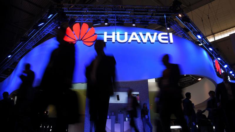 Visitors pass a Huawei marquee in Barcelona during the Mobile World Congress last year. The daughter of the Chinese telecommunications giant's founder was arrested Saturday in Canada on U.S. request, in a move that threatens to inflame U.S.-China trade te