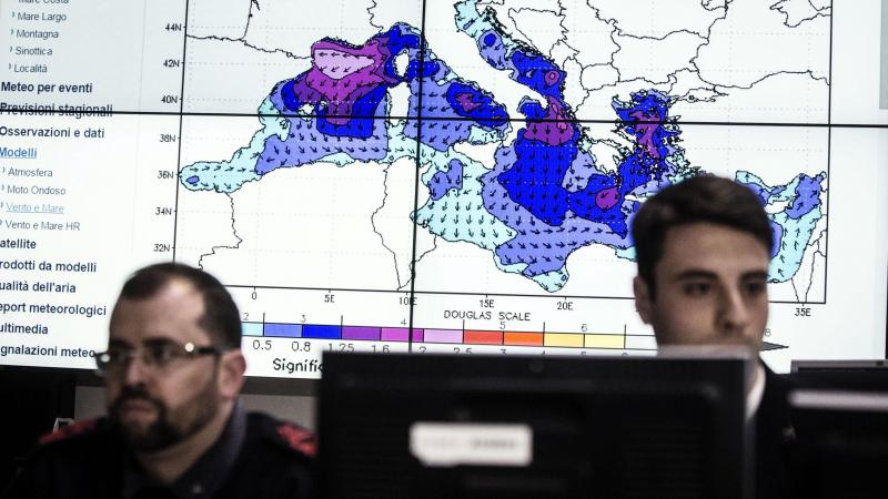 Personnel at work in the operations room of the Italian coast guard in Rome on Sunday during the coordination of relief efforts after a ship carrying hundreds of migrants capsizes off Libyan coast occurred in the Strait of Sicily.