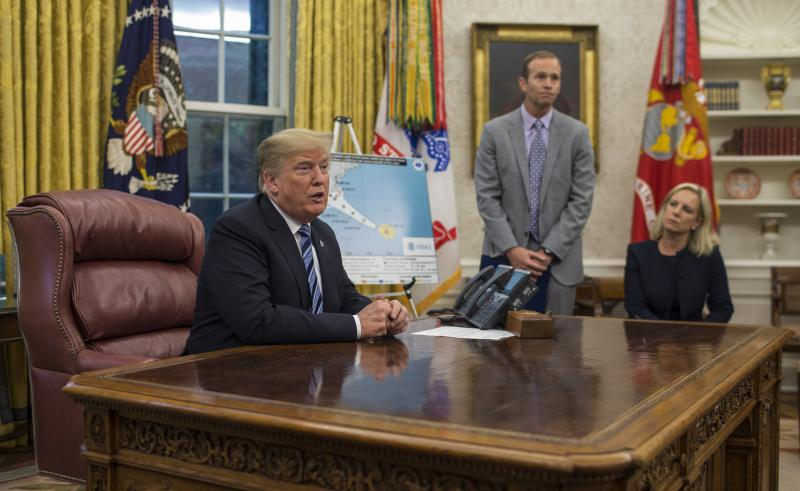 President Trump holds a briefing on Hurricane Florence in the Oval Office on Tuesday with FEMA Administrator Brock Long and Homeland Security Secretary Kirstjen Nielsen.