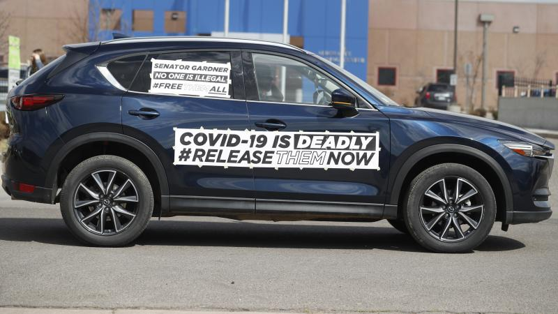 A sign on a vehicle during a protest outside an ICE detention center in Colorado. Immigration lawyers are calling for the release of detainees as the coronavirus spreads at ICE facilities around the country.