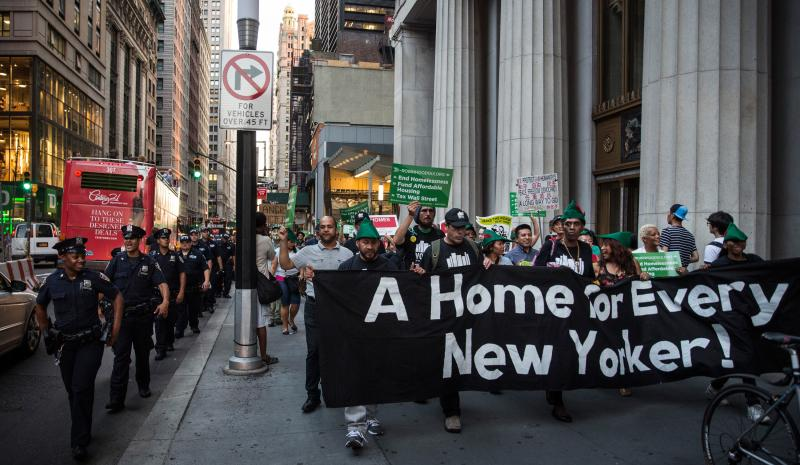 Housing activists march to City Hall to demand more affordable housing options for the homeless and poor on Sept. 17 in New York City.
