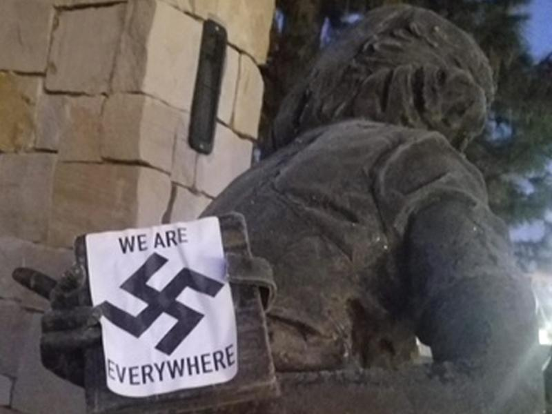 A swastika sticker on a statue at the Idaho Anne Frank Human Rights Memorial in Boise. The vandalism took place sometime between Monday evening and Tuesday morning, Boise police said.