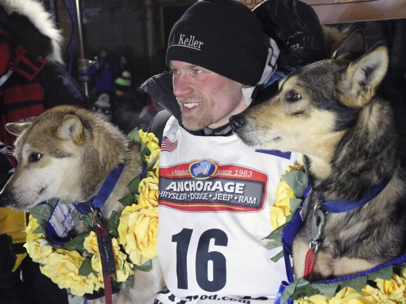 Dallas Seavey poses with his lead dogs Reef (left) and Tide after finishing the Iditarod Trail Sled Dog Race in Nome, Alaska, in March 2016. Seavey denies he administered banned drugs to his dogs in this year's race and has withdrawn from the 2018 race in
