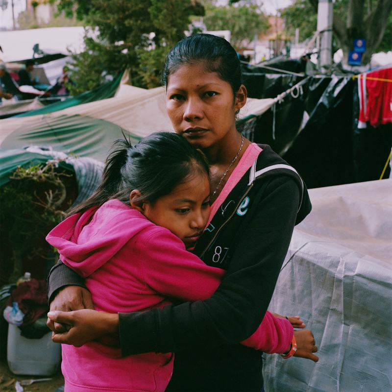 "Karen Paz hugs her daughter, Liliana Saray, 9. They are from San Pedro Sula, Honduras. ""I feel free; I feel different,"" Paz said. ""I don't have someone who imposes his views and his ways on me. I am not scared someone will come and attack me, like I used"