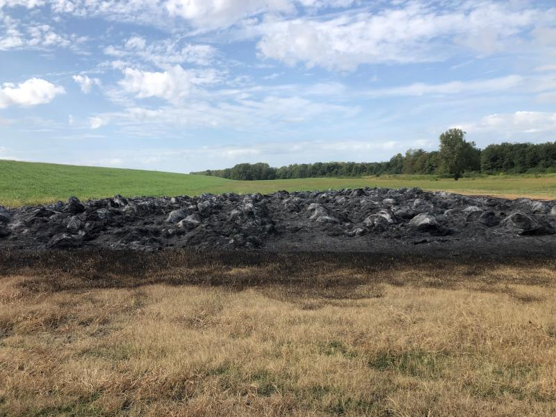 Vandals struck Terry Fuller's farm a few days ago, burning 367 bales of hay. Fuller is trying to limit use of a herbicide called dicamba, which has pitted farmers against each other.
