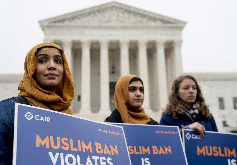 Zainab Chaudry (from left), Zainab Arain and Megan Fair with the Council on American-Islamic Relations, stand outside of the Supreme Court for an anti-Trump travel ban rally before oral arguments.