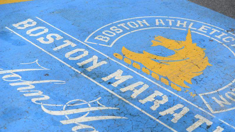 The finish line of the Boston Marathon, normally freshly painted this time of year, is still visible on Boylston Street in Boston on April 16, 2020, just a few days ahead of the planned but now rescheduled date.