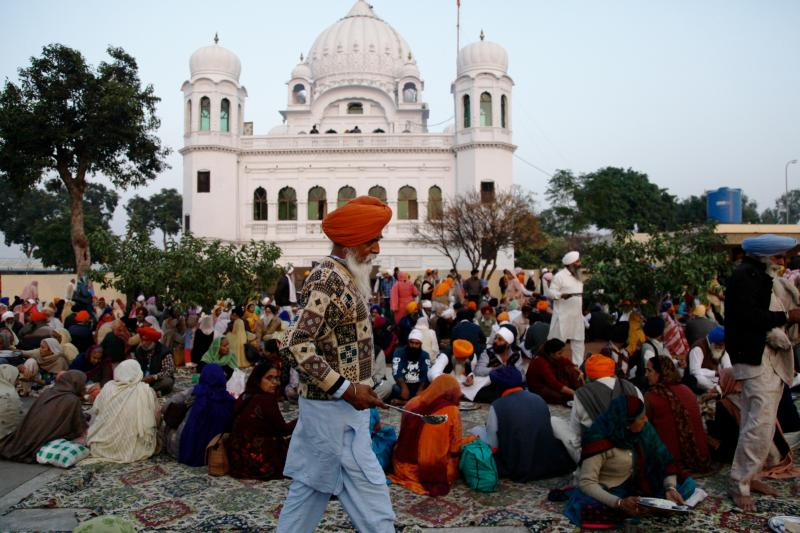 Sikh worshippers gather outside their holiest site, the Gurdwara Darbar Sahib Kartarpur. It is believed to be the place where the founder of Sikhism, Guru Nanak, died in the 16th century. In a rare goodwill gesture this week, India and Pakistan broke grou