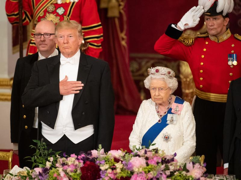 Britain's Queen Elizabeth II hosts President Trump for a state banquet in the ballroom at Buckingham Palace in London on Monday, the first day of the U.S. president and first lady's three-day state visit to the U.K.