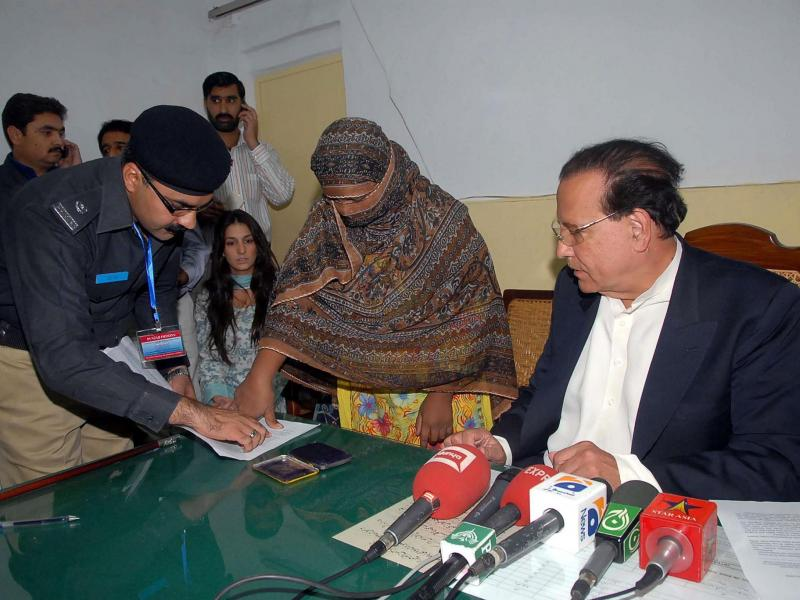 At the jail where she was held in 2010 after being sentenced to death for blasphemy, Asia Bibi affixed her thumbprint as signature on a mercy petition to Punjab's provincial governor, Salman Taseer, at right. Taseer had expressed support for Bibi and was