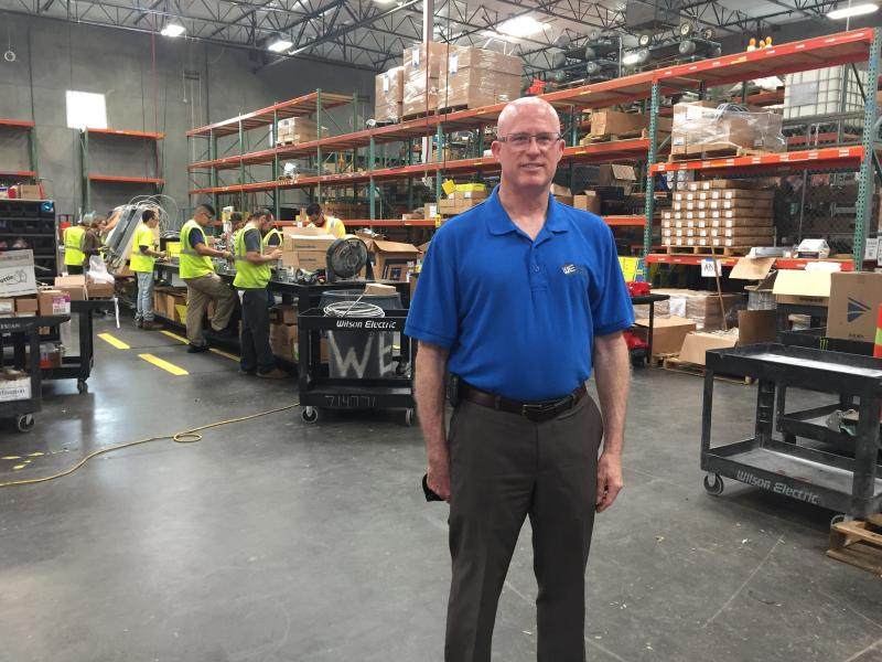 Mark Holohan, solar division manager at Wilson Electric, stands in his company's warehouse outside Phoenix, Ariz. Solar installers say a proposed tariff could sink their business model, while several solar manufacturers say they need shelter from an overs