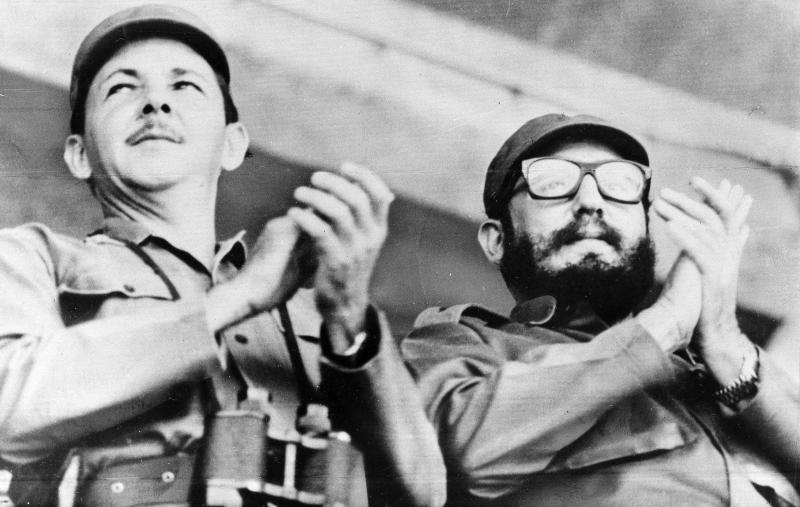 Cuban leader Fidel Castro (right) and his brother Raúl Castro, the head of the military, at a 1964 event in Santiago, Cuba. New details of the first CIA attempt to kill the Castros — a 1960 plot against Raúl — have recently emerged.