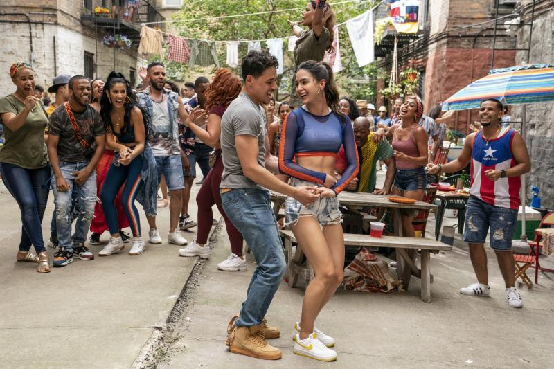 Anthony Ramos and Melissa Barrera play Usnavi and Vanessa in the film In the Heights.
