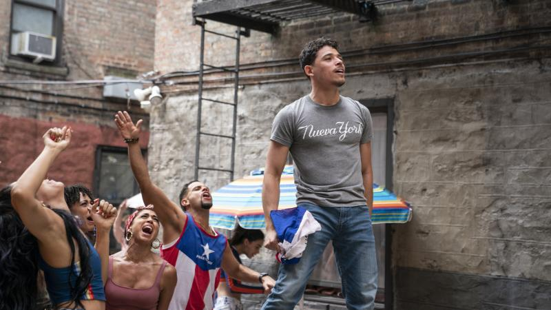Usnavi (Anthony Ramos) runs a corner bodega and dreams of returning to the Dominican Republic in In the Heights.