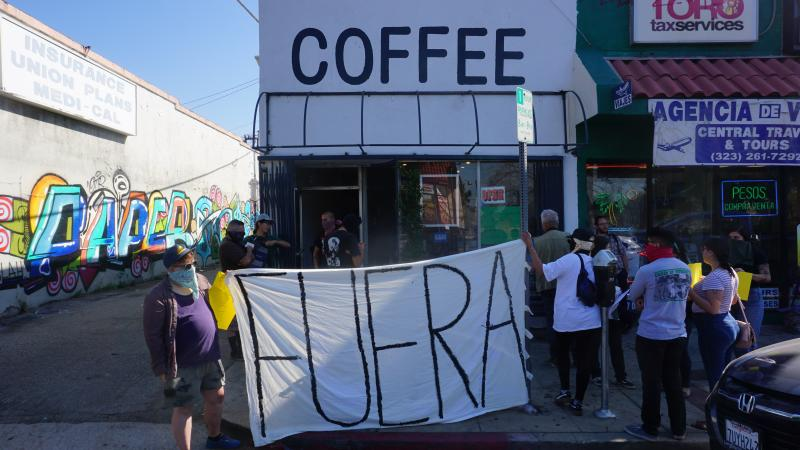 """Anti-gentrification activists staged a protest outside Weird Wave Coffee Brewers recently, chanting """"Weird Cafe has got to go."""""""