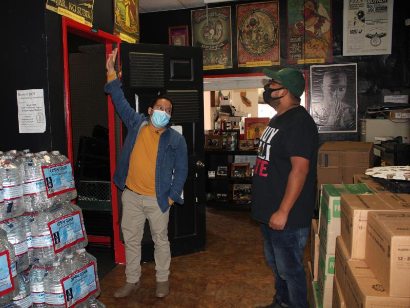 Radio B'alam founders Henry Sales and Crecensio Ramirez check out Radio B'alam's sound booth at Homies Empowerment the day before the shows first broadcast, December 2020.