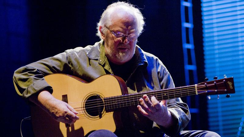 John Renbourn performs  onstage at the Royal Festival Hall in London June 29, 2008. The influential guitarist died at his home in Scotland Thursday. He was 70.