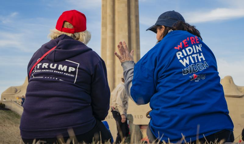 Supporters of President Trump and his Democratic challenger, former Vice President Joe Biden, talk in Kansas City, Mo.