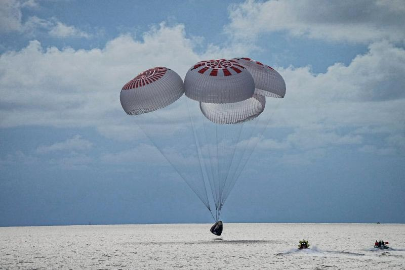 In this image provided by SpaceX, a capsule carrying the all-amateur Inspiration4 crew parachutes into the Atlantic Ocean off the Florida coast on Saturday, Sept. 18, 2021.