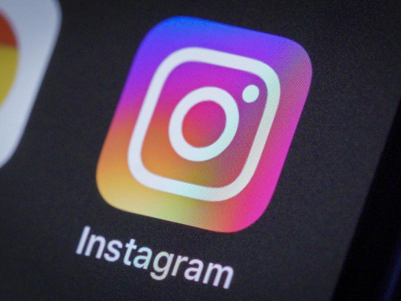 The Instagram photo sharing app is seen on an iPhone 11 Pro Max on April 4. Sarah Frier details the app's rise in her book No Filter: The Inside Story of Instagram.
