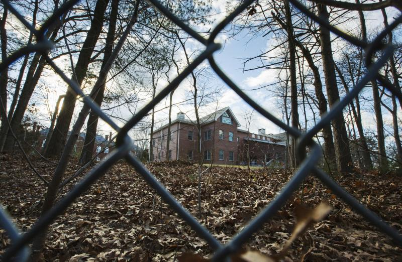 A fence surrounds an estate in the village of Upper Brookville in the town of Oyster Bay, N.Y., on Long Island. On Friday, the Obama administration closed this compound for Russian diplomats, in retaliation for spying and cyber-meddling in the U.S. presid