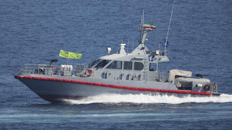 Iran says its military seized a foreign oil tanker in the Strait of Hormuz. In this 2018 photo, a boat from the Islamic Revolutionary Guard Corps' naval force is seen in the Persian Gulf, near the strait.