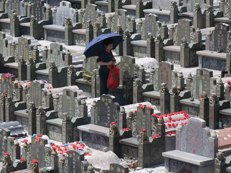 """People mourn their ancestors and the deceased at a cemetery in Quanzhou during the traditional Qingming Festival, or """"Tomb-sweeping Day."""""""