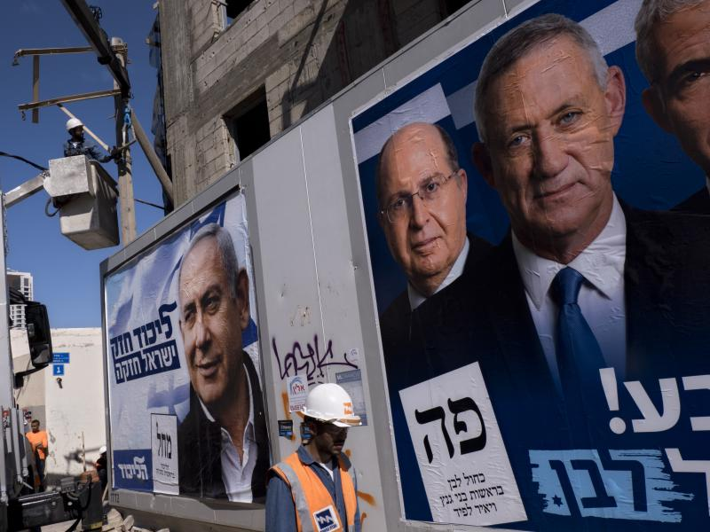 Election campaign billboards in Tel Aviv showing Israeli Prime Minister and head of the Likud party Benjamin Netanyahu (left), alongside the Blue and White alliance leaders Moshe Yaalon and Benny Gantz.