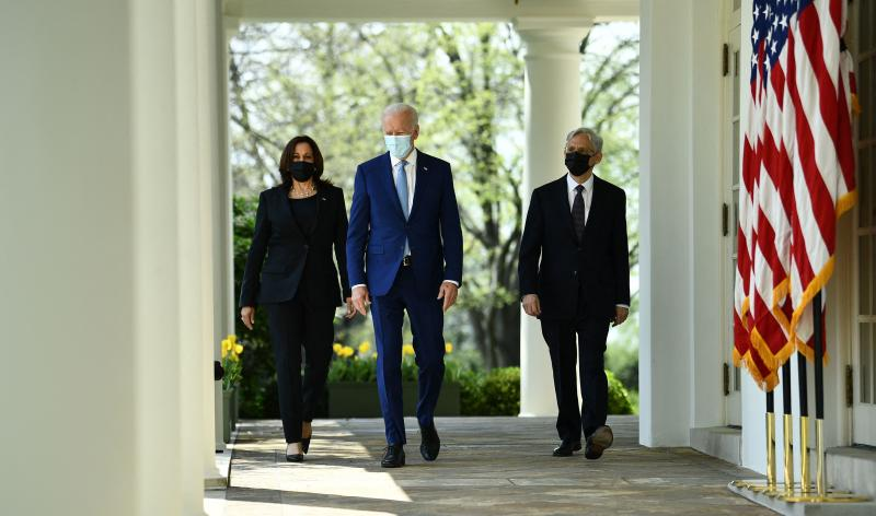 Vice President Harris, President Biden and Attorney General Merrick Garland arrive Thursday at the White House Rose Garden to speak about gun violence prevention.