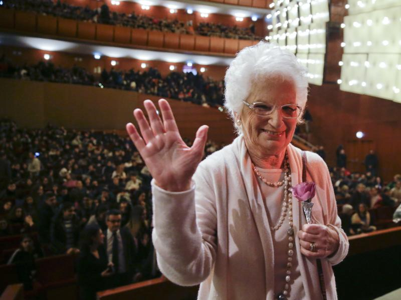 Liliana Segre waves at the end of a meeting with students in Milan, Italy, in 2018. For decades, Segre, 89, was reluctant to discuss her time in the Auschwitz concentration camp. But in the 1990s, she began speaking to schoolchildren throughout Italy abou