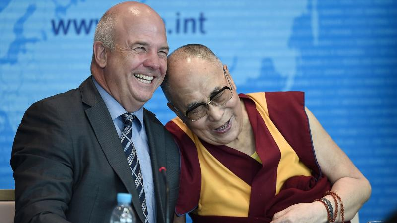 Outgoing European human rights Commissioner Nils Muiznieks (L) shares a joke with the Dalai Lama at the Council of Europe in Strasbourg, France, in 2016.