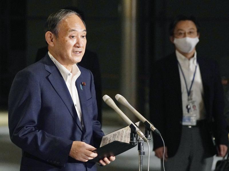 Japanese Prime Minister Yoshihide Suga speaks to reporters about lifting of a state of emergency at his official residence in Tokyo Monday, Sept. 27. Suga announced Tuesday a lifting of the ongoing coronavirus state of emergency and less-stringent measure