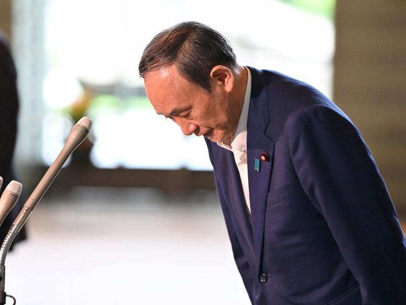 Japan's Prime Minister Yoshihide Suga bows during a press conference at the prime minister's office in Tokyo on Friday, following his announcement that he will not seek reelection for Liberal Democratic Party leadership this month.