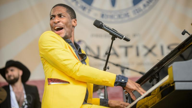 Jon Batiste, seen here at the 2014 Newport Jazz Festival, will take on a new gig as the bandleader for CBS' Late Show With Stephen Colbert.