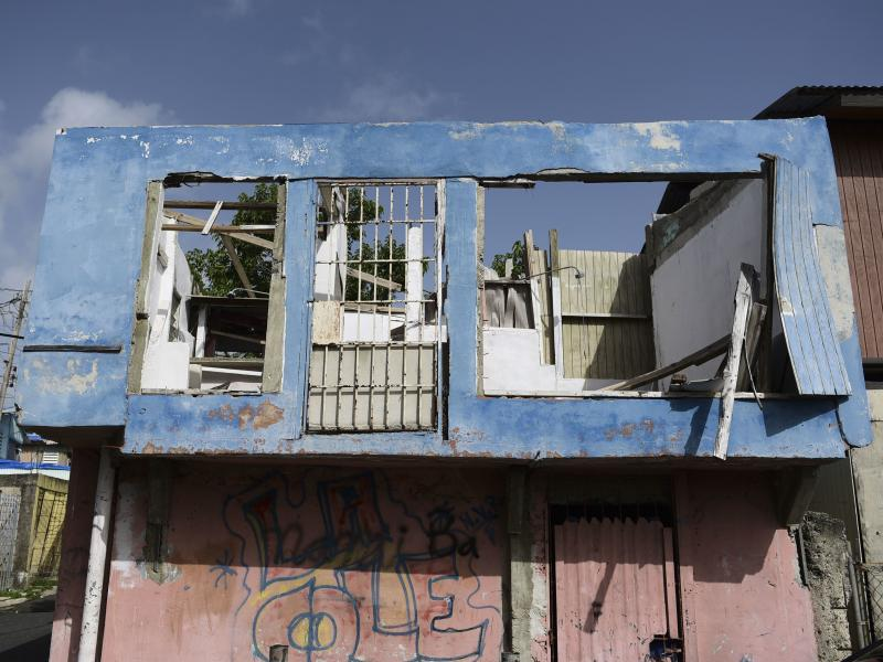 In this June 13 photo, a residence in the Figueroa neighborhood stands destroyed nine months after Hurricane Maria, in San Juan, Puerto Rico. On Wednesday a federal judge extended a temporary housing program for territory residents whose homes were destro