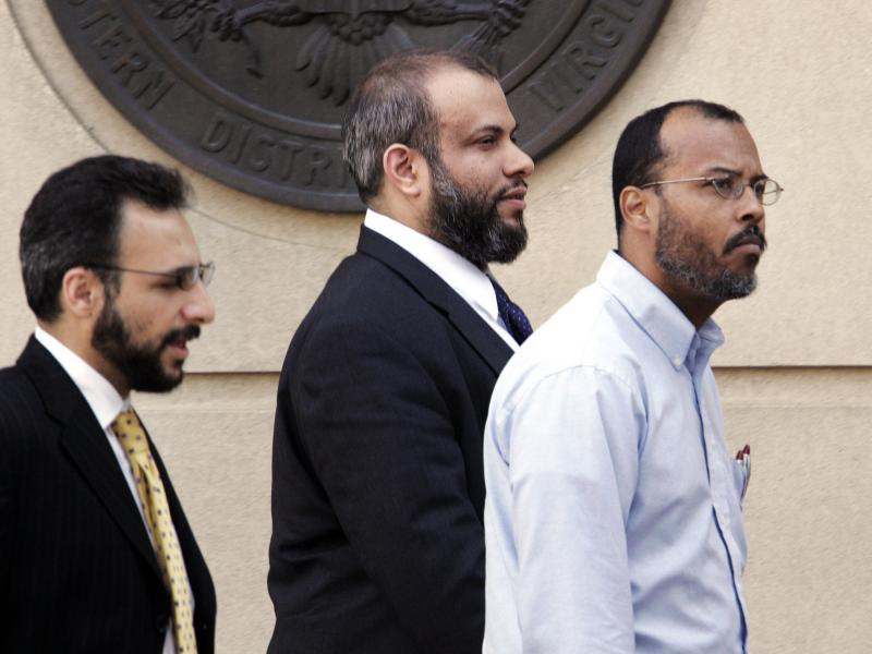 Ali Al-Tamimi (center) walks with two unidentified men as they leave federal court in Alexandria, Va., in April 2005. A federal judge has ordered him released from prison pending the outcome of his appeals, which have been unresolved for more than a decad