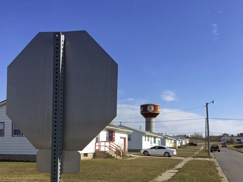 Residential roads with no street name or number signs, such as this one in Belcourt, N.D., are common on the Turtle Mountain Indian Reservation. Under recently tightened state rules, voters in North Dakota are required to present identification with a str