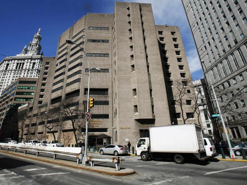 The warden of the Metropolitan Correctional Center in New York City has been reassigned and two others suspended pending official investigations, the Justice Department said.