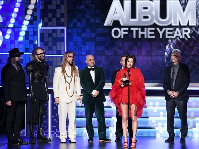 Kacey Musgraves (speaking at microphone) won the Grammy for best album of the year for Golden Hour.