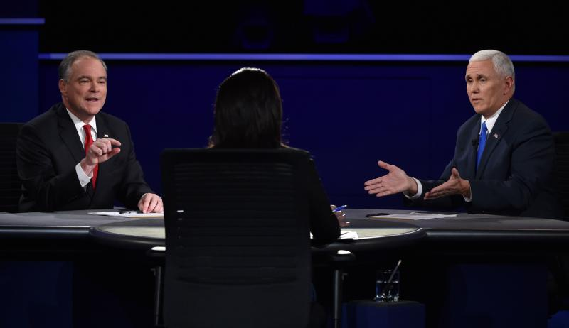 Tim Kaine (left) and Mike Pence take questions from moderator Elaine Quijano during the vice presidential debate at Longwood University in Farmville, Va., on Tuesday.